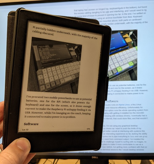 A Kindle with a website repackaged as an ebook. A monitor in the background shows the same website article.